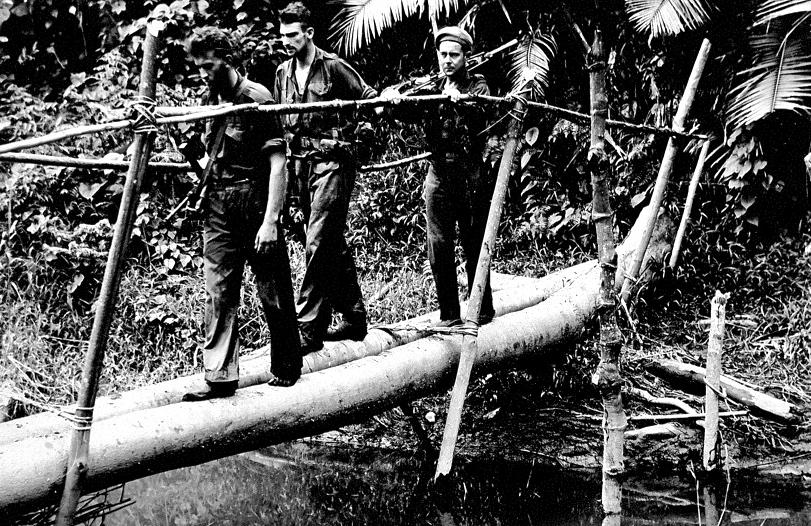 Crossing-a-makeshift-bridge-in-New-Guinea-L-R-Stan-King-Merv-Cash-and-Lionel-Newton.jpg