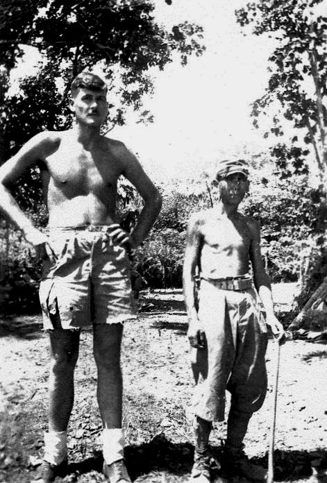 Tony-Bowers-stands-alongside-a-Japanese-prisoner.jpg
