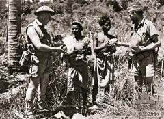 NATIVES-BRING-IN-FRESH-FRUIT-TO-THE-TROOPS.jpg
