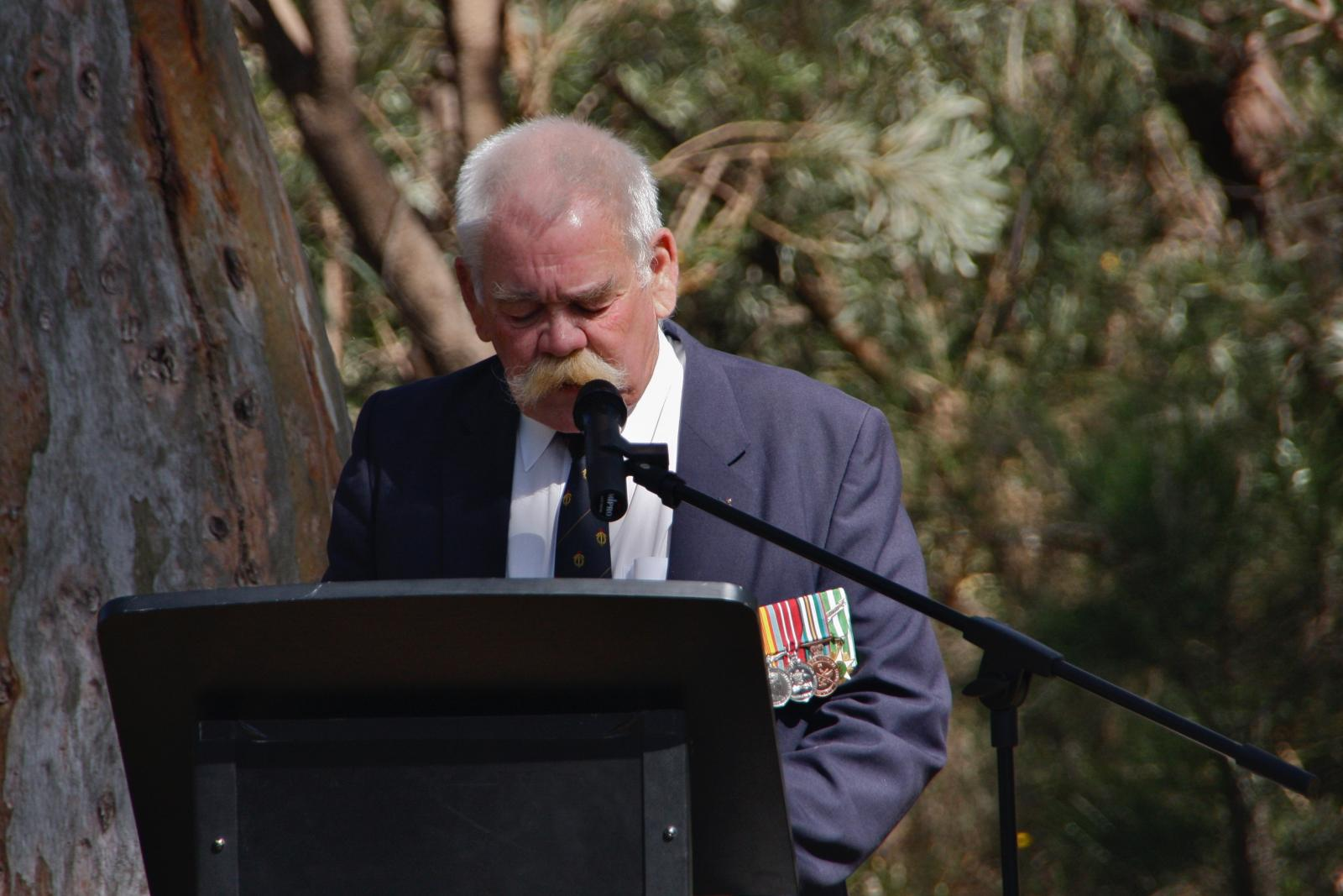 John Burridge reads the names of the fallen.