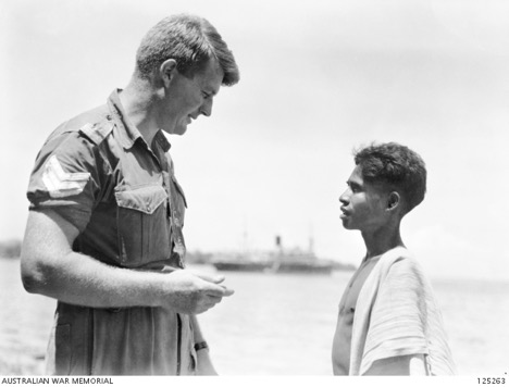 125263 - Dili, Portuguese Timor.  1946-01-12.  Sergeant (Sgt) Milsom, Military History Section Field Team, talking to Manuberi who was his creado.jpg